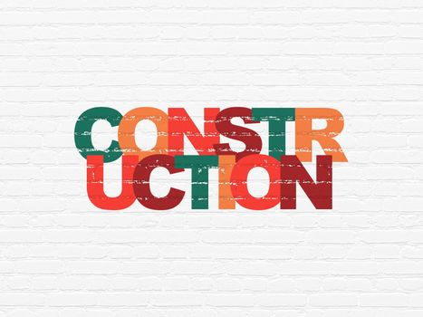 Building construction concept: Painted multicolor text Construction on White Brick wall background