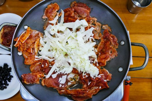 Pork Calbi, meat and vegetable on the pan, tradition of Korean food.
