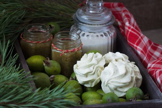 Winter feijoa tasted zephyr or marsmallows in the vintage wooden box with jam and sugar