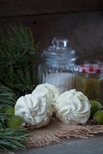 Winter feijoa tasted zephyr or marsmallows on the wooden background