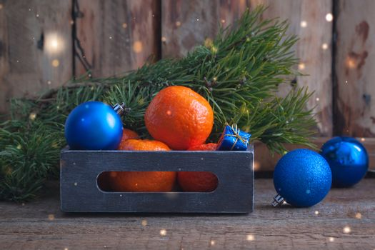 Tangerines with Blue Christmas balls in the vintage box