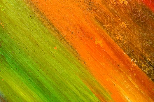Long neat smears of orange and green paint.