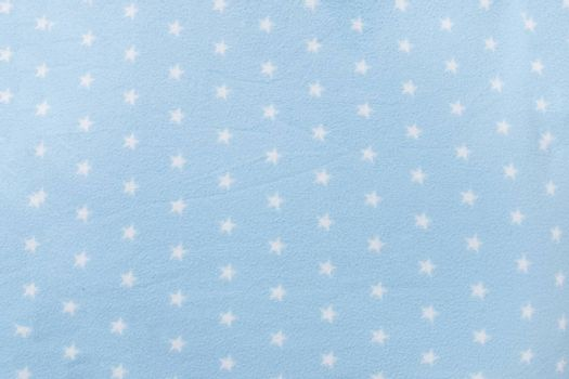 Texture background of a star shape blue wool blanket.