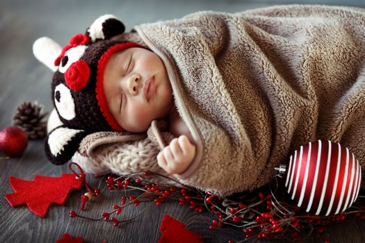Sweet baby boy sleeping in Christmas eve