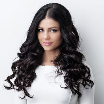 Woman with long curly black hair