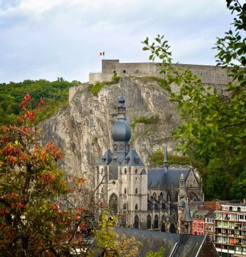 Landscape of Dinant Citadel and Collegiale Notre Dame of Our Lady in Sunny Autumn Day Outdoors. View from Hill Dinant, Belgium