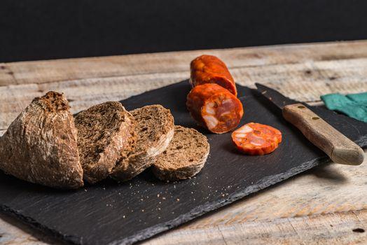Malt loaf bread and chorizo slices