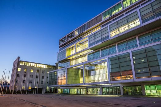 Exterior of Slovenian Chamber of Commerce at dusk.