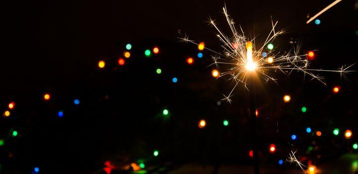 Sparkler and Christmas lights.