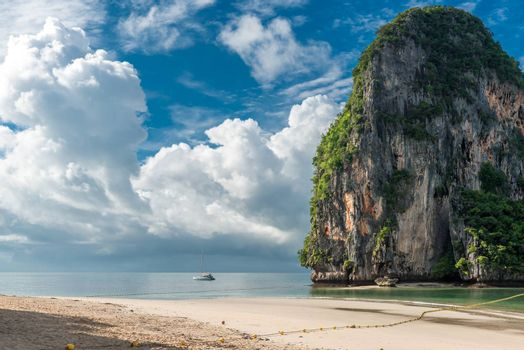 yacht near a rock in the Andaman Sea before the storm