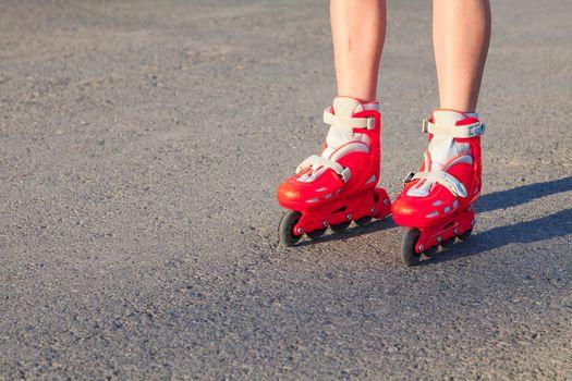Legs of a young girl or a boy as she or he is rollerskating