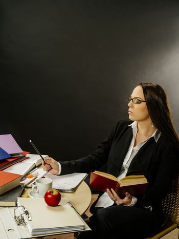 Woman sitting at her desk writing