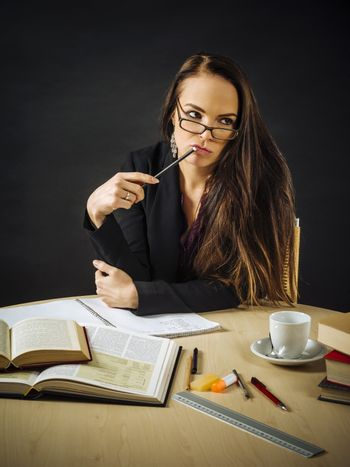 Woman sitting at her desk thinking