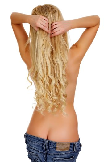 Voluptuous blonde woman in blue jeans, view from behind, isolated on white background