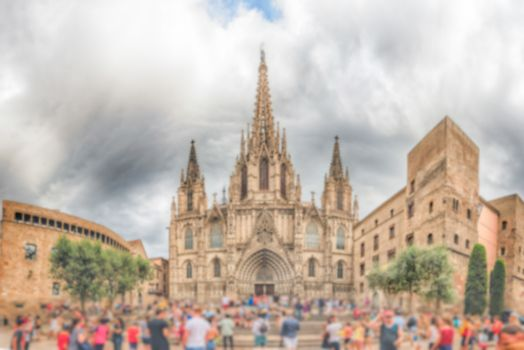 Defocused background with facade of the Barcelona Cathedral, Cat