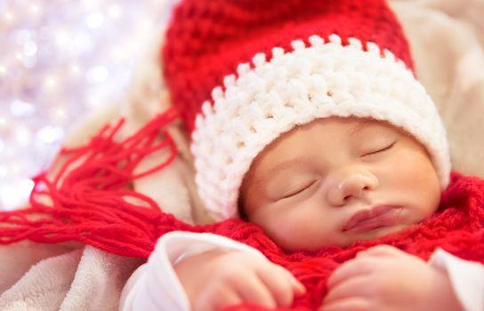 Sweet baby sleeping in Christmas costume
