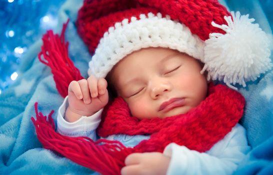Newborn baby sleeping on Christmas eve