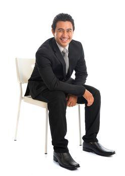 Seated Southeast Asian businessman