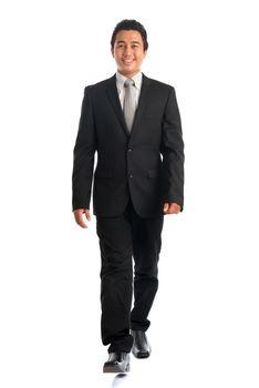 Southeast Asian businessman walking