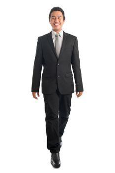 Full body Asian businesspeople walking