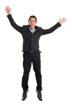 Southeast Asian businessman jumping