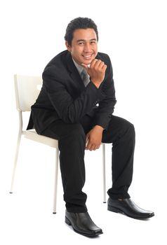 Southeast Asian businessman sitting