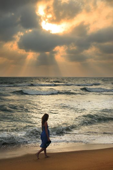 Girl on a beach on sunset in Sri Lanka