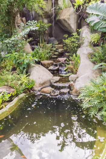Man-made small waterfall in tropical garden