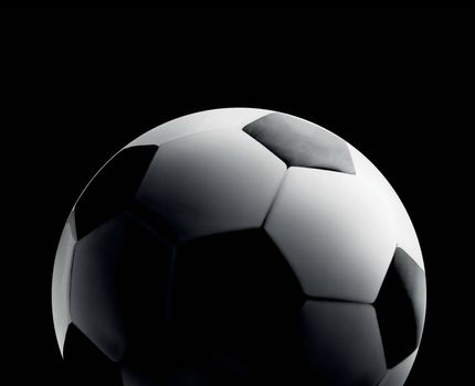 Soccer or football ball ball in the backlight on black background. Vector close-up illustration
