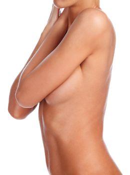 Closeup shot of beautiful female body. Slim woman posing. Isolated on white background