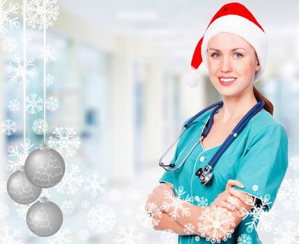 Smiling doctor wearing red santa hat, christmas time concept
