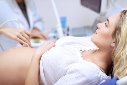 Pregnant woman doing ultrasound scan