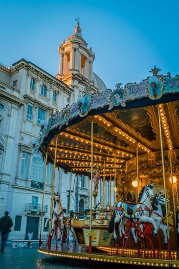 Merry-go-round and church in Rome