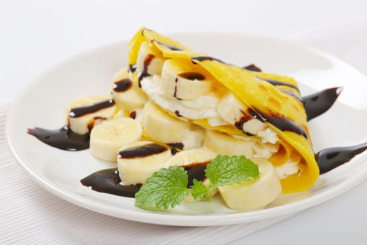 thin pancakes with banana and whipped cream