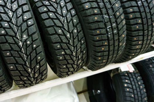 Closeup shot of car tyres on a shelf