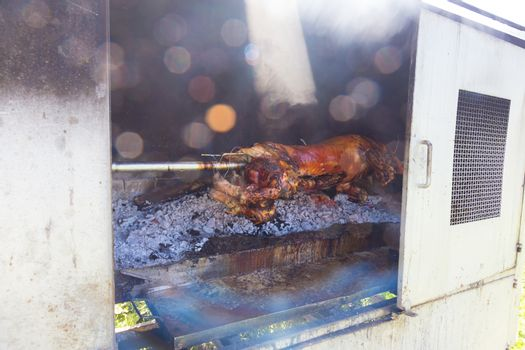 Traditional balkan dish - whole piglet grilled on the open fire.