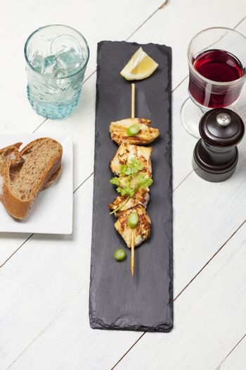 overview of grilled chicken skewer with cilantro