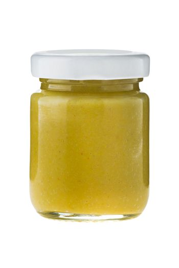 Hot chili mustard in glass on white background