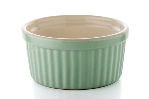 Green ceramic bowl on white reflective background