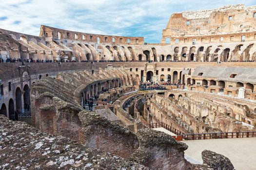 Interior of Colosseum, iconic symbol of Imperial Rome on cloudy day in Rome, Italy