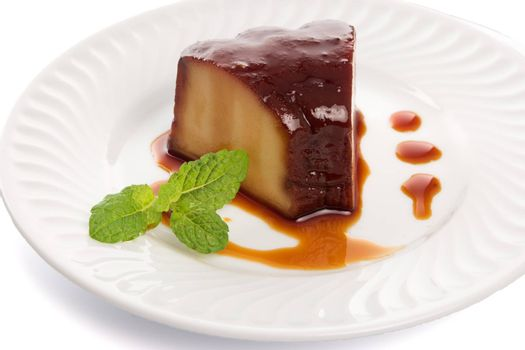 "Homemade Pudding ""Pudim Caseiro"" slice on a white ceramic plate, a Typical Portuguese Desert."