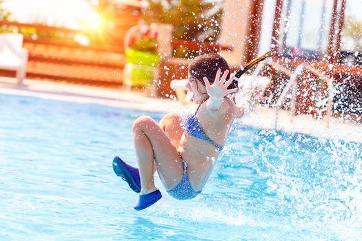 Joyful girl in the pool