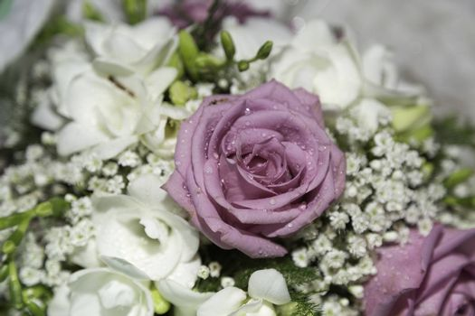 Wedding Bouquet Close Up with a pink rose in the center.