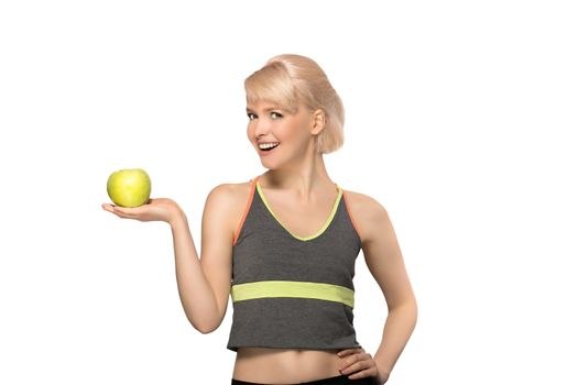 Happy smiling slim woman holding green apple, studio portrait isolated on white background, healthy lifestyle concept