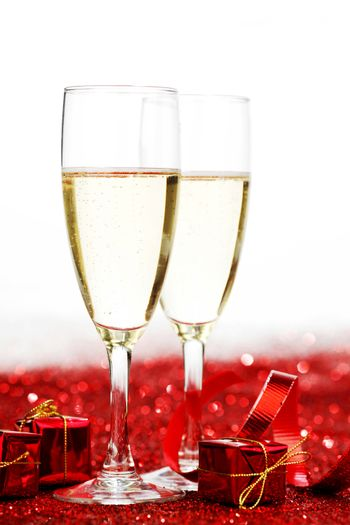 Two glasses of champagne with red decor, Valentines day concept