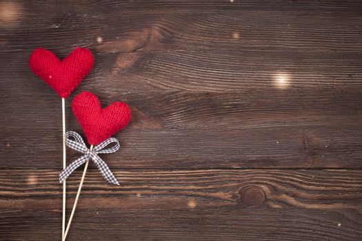 Knitted Love hearts on a wooden background, valentines day post card concept