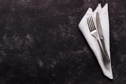 Vintage cutlery on dark background
