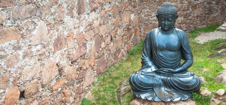 Meditating Buddha Statue, made of bronze. 19th Century, sitting stance, useful copyspace.