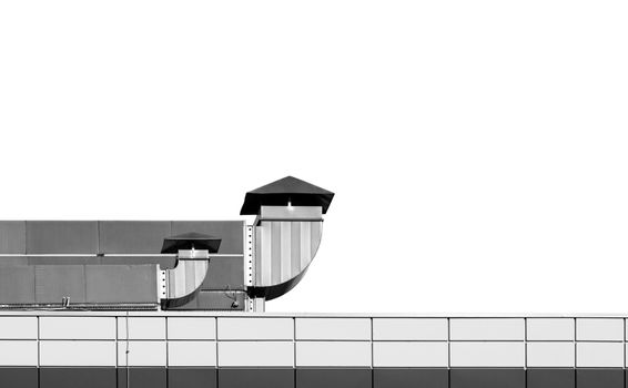 Industrial building roof with ventilation chimneys on white background, black and white picture