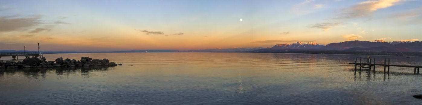 Sunset with beautiful moon over Leman or Geneva lake, Excenevex, France